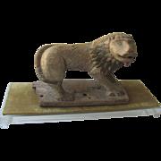 Folk Art Carved Lion on Lucite Base