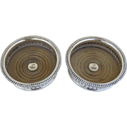 Pair of Early Sheffield Silver Wine Coasters with Silver Engraved Button and Gadrooned Border.