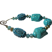 SOLD Carved Turquoise Beads with Buddha Charms Bracelet