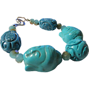 """Carved Buddha Head Charms with Turquoise Bead Bracelet, 9"""""""