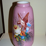Pink cased glass with red bird and roses