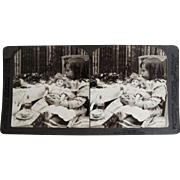 Underwood &Underwood Stereoview Card- Child With Doll & Sick Cat.