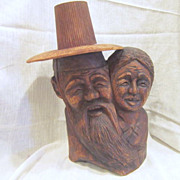 Wooden Carved Heads Asian Older Couple