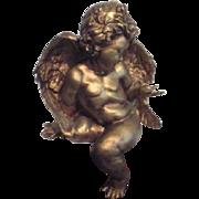 Golden Chalk Angel Sits on Shelf
