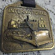 Vintage Watch Fob with International Bulldozer