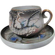 Dragonware Demitasse Cup and Saucer with Geisha Girl Face Inside Cup