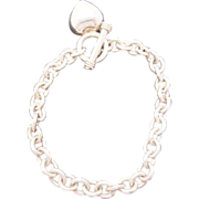 Fashionable silver link toggle bracelet with heart