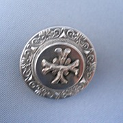 Silver plate Victorian pin, raised center, applied design, c. 1890