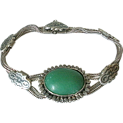 Silver and Niello Bracelet with Large Green Stone