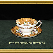 Hammersley Bone China Cup and Saucer in Apricot with Gold trim and medallions filled with flor