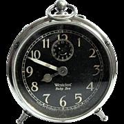 "SOLD Art Deco ""Baby Ben"" Peg-leg Black Luminous Dial Alarm Clock, 1920s"