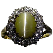 REDUCED Cat's eye chrysoberyl and diamond cluster ring.