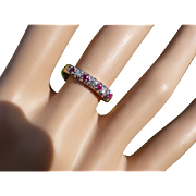 This a charming 7 stone Diamond & Ruby halt eternity Ring