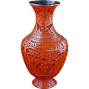 Chinese carved red lacquer cinnabar vase with garden scene circa 1900