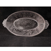 Victorian clear glass EAPG relish dish circa 1870 of cupids hunting and fishing
