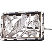 Chinese rectangular silver pin of a crested bird on a branch circa 1900