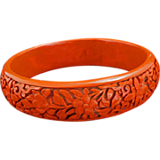 Chinese deeply cut red cinnabar 17 mm bangle bracelet with peony scrolling circa 1900