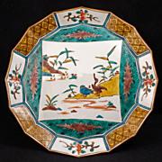 Japanese porcelain Meiji era (1868-1912) faceted ao-kutani plate with central scene of ...