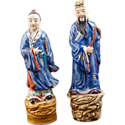 Pair of Chinese porcelain immortal figures riding clouds with over glaze enamel decoration cir