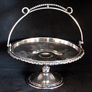 Victorian Silver Plate Cake Basket with Cupids Pulling Floral Wagons by Wilcox circa 1875