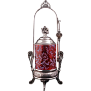 REDUCED Pairpoint silver plate pickle castor with cranberry glass jar circa 1880