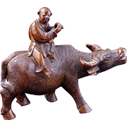 Chinese hardwood carving of a boy on a water buffalo circa 1900
