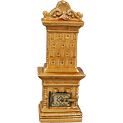 Beautifully Modeled Heating Stove, in Mustard Glazed Pottery