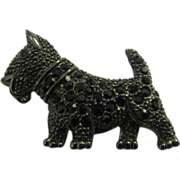 1928 Scottie Dog pin done in Japanned metal with black rhinestones