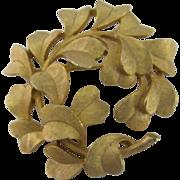 SALE Crown Trifari gold-tone wreath leaf brooch