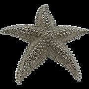 Monet large silver tone star fish brooch