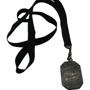 Sterling Locket on grosgrain ribbon with watch chain swivel marked FMCO