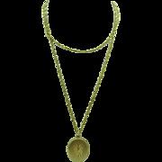 "1970's 14k gold Oval Locket with star burst design on 30"" 14K gold chain"