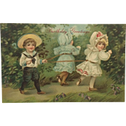 Little Boy In Straw Hat And Two Little Girls In Bonnets Playing-Matte Finish