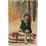 Tinted Postcard- Little Girl In Green Coat On Sled