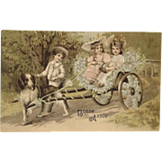 Two Little Girls In Bonnets Ride In Style In Dog Cart