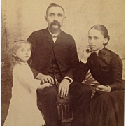 SOLD Cabinet Card- Beautiful Little Girl With Father And Mother Holding Memento