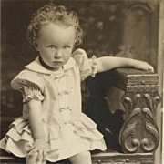 SOLD RPPC- Curly Haired Toddler In Summer Dress