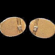 Fourteen karat yellow gold cuff links with a little Diamond