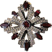 Silver brooch adorned with seed pearls and Garnets, dated at about 1920