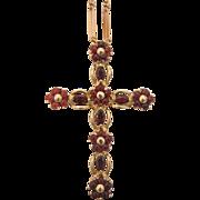 Garnet cross pendant set in fourteen karat yellow gold, ca. 1970