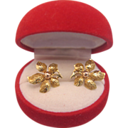 A pair of fourteen karat yellow gold flower earrings, ca. 1950
