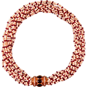 Natural seed pearl and Ruby necklace with a Diamond and Garnet cabochon closure, set 18 ...