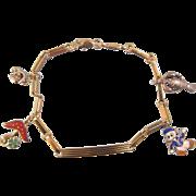 Eighteen karat yellow gold enamel charm bracelet, ca. 1950