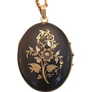 Art Nouveau black enamel locket, 14K yellow gold and seed pearls, ca. 1900