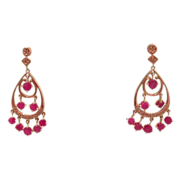 A pair of Diamond and Ruby ear studs, set in fourteen karat yellow gold dated at about 1960