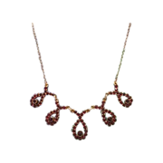 Garnet and gilded silver necklace with looped scroll motifs, 19th century