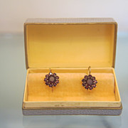 Pair of Garnet earrings set in fourteen karat yellow gold,early 20th century