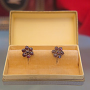 Pair of fourteen karat yellow gold and Garnet ear studs, ca.1950