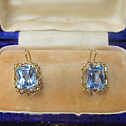 SOLD Fourteen karat yellow gold and blue Topaz earrings, dated at about 1950