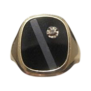 Fourteen karat yellow gold and Onyx ring , dated at about 1950